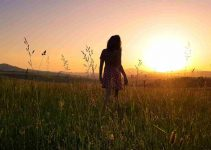 Girl in Field Sunset