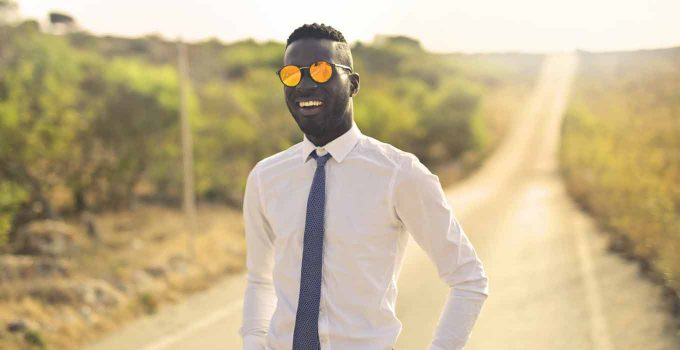 Man in sunglasses on road