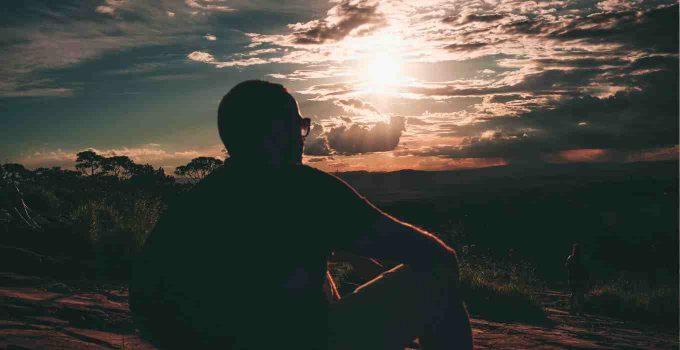 Man contemplating in sunset