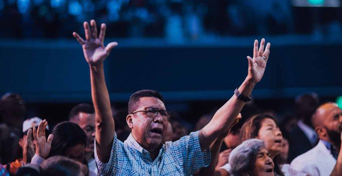 People Worshipping God in Church - Missions